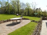 The rear garden has a patio with table and chairs, and also a rotary washing line.
