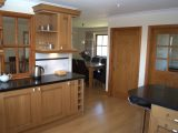 The kitchen is fitted with a range of oak units and granite worktops.