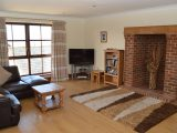 "The lounge features an inglenook fireplace, a 42"" flat screen TV with Freeview, and DVD player."